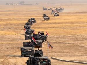 Forças iraquianas mantêm ofensiva para expulsar EI de Mossul (Foto: Khalid Mohammed/AP)